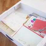 Inside of box that organizes children's artwork