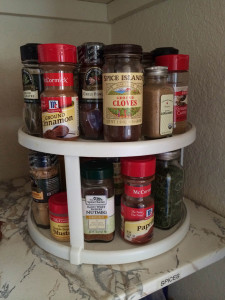 A professional organizer evalutes a spice turntable