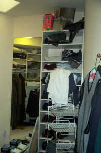 unorganized closet shelves